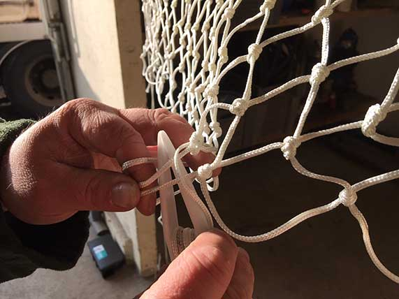 réparation filets de pêche